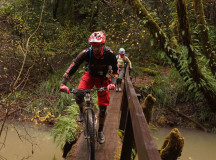 Log bridge over flood stage waters of the Little North Fork of Big River (say that ten times fast)… looks wider than it is. Photo: Mendocino Bike Sprite